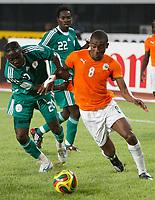 Photo: Steve Bond/Richard Lane Photography.<br />Nigeria v Ivory Coast. Africa Cup of Nations. 21/01/2008. Salomon Kalou (R) battles past  Onyekachi Okonkwo (L)