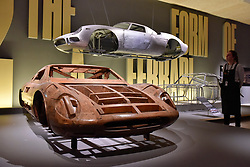 "© Licensed to London News Pictures. 14/11/2017. London, UK.  A wooden model for the Ferrari 365 P, 1966, by Pininfarina and an aluminium body shell for the Ferrari 250 LM, 1964. Preview of ""Ferrari: Under the Skin"", an exhibition at the Design Museum to mark the 70th anniversary of Ferrari.  Over GBP140m worth of Ferraris are on display from private collections including Michael Schumacher's 2000 F1 winning car.  The exhibition runs 15 November to 15 April 2018.  Photo credit: Stephen Chung/LNP"