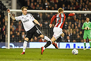 Fulham Midfielder Stefan Johansen (8) and Sheffield United Midfielder Mark Duffy (21) battle for the ball during the EFL Sky Bet Championship match between Fulham and Sheffield United at Craven Cottage, London, England on 6 March 2018. Picture by Stephen Wright.