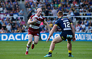 Liam Farrell (L) of Wigan Warriors on the attack against Jack Hughes (R) of Warrington  Wolves during the Betfred Super League match   at the Dacia Magic Weekend, St. James's Park, Newcastle<br /> Picture by Stephen Gaunt/Focus Images Ltd +447904 833202<br /> 19/05/2018