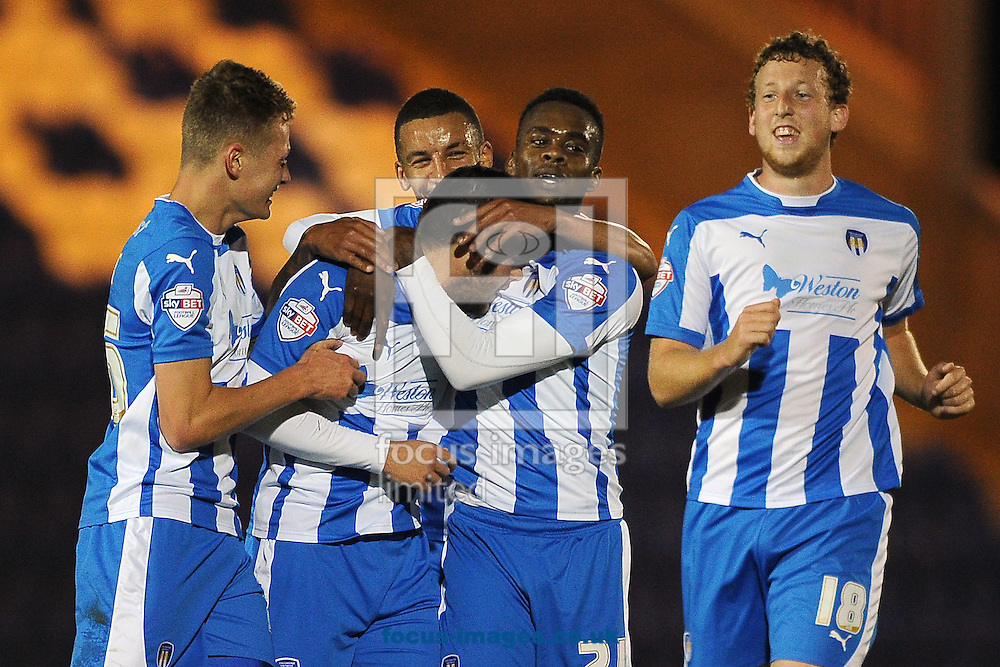 Drey Wright of Colchester United celebrates scoring a goal to make the scoreline 1-0 during the Johnstone's Paint Trophy match between Colchester United and Gillingham at the Weston Homes Community Stadium, Colchester<br /> Picture by Richard Blaxall/Focus Images Ltd +44 7853 364624<br /> 07/10/2014