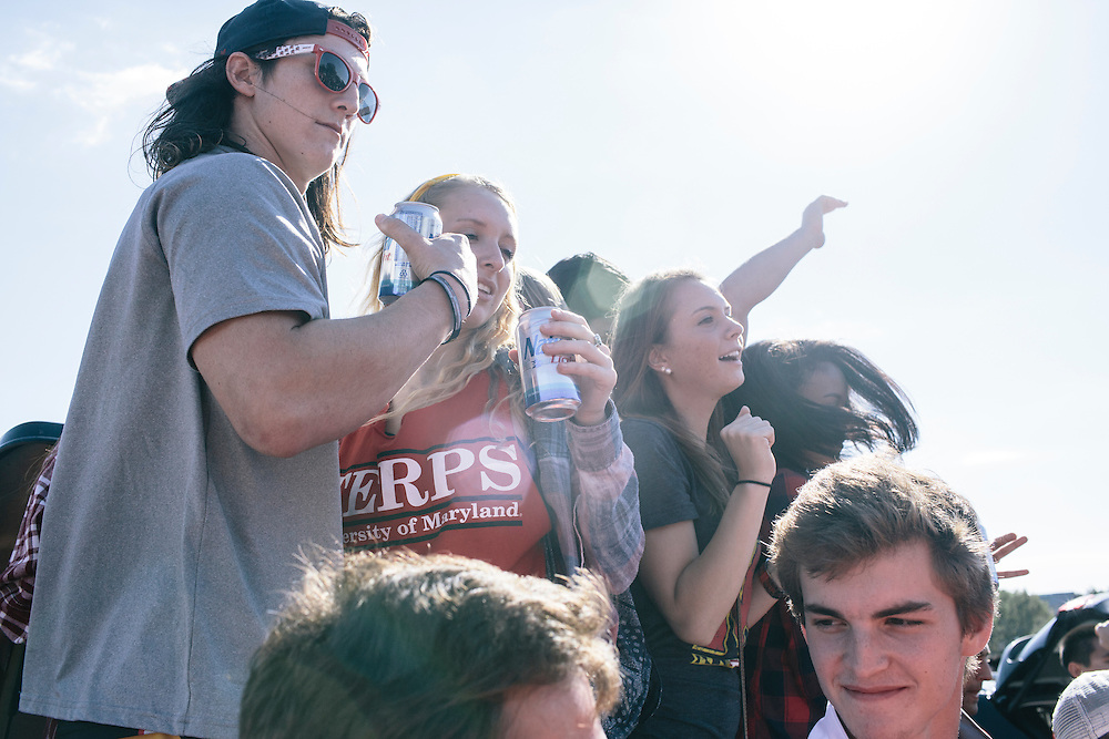 University of Maryland students and alumn dance on the back of a truck and drink in the main parking lot outside of Capital One Field at Byrd Stadium during homecoming weekend on Oct. 18, 2014.