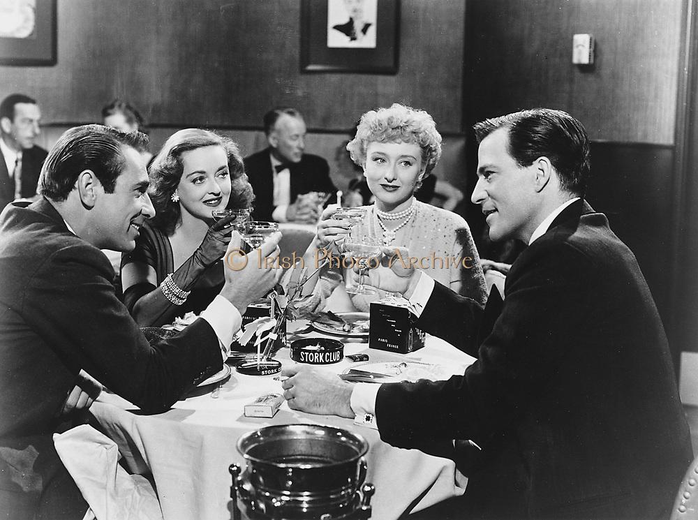 ALL ABOUT EVE, Fox, 1950. Producer: Darryl F. Zanuck. Director: Joseph L. Mankiewicz. Starring Bette Davis. Left to right: Garry Merrill, Bette Davis as Carol Channing, Celeste Holm, Hugh Marlow