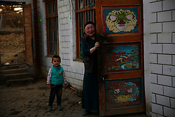 An ethnic Uighur woman and child greets visitors in their home in Turpan, Xinjiang Uighur Autonomous Province, China, 17 November 2017. Uighurs, a Muslim ethnic minority group in China, make up about 40 per cent of the 21.8 million people in Xinjiang, a vast, ethnically divided region that borders Pakistan, Afghanistan, Kazakhstan, Kyrgyzstan and Mongolia. Other ethnic minorities living in here include the Han Chinese, Kyrgyz, Mongolian and Tajiks people. Xinjiang has long been subjected to separatists unrests and violent terrorist attacks blamed by authorities on Islamist extremism while human rights groups say Chinese repression on religious rights, culture and freedom of movement caused undue tensions. Life however goes on under the watchful eye of the government for the ethnic Uighurs living in the city of Urumqi and surrounding areas and the region is still considered an attractive tourist spot. A recent report by state media Xinhua news agency claims Xinjiang received more than 100 million tourists in 2017, 'the highest figure in its history'.