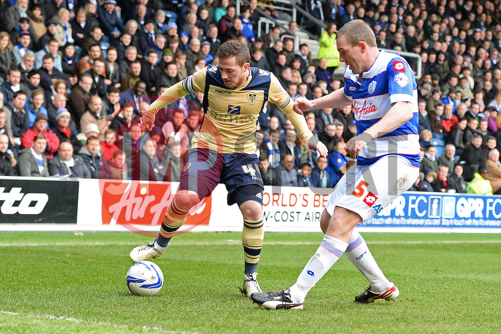 Leeds United's Ross McCormack and QPR's Richard Dunne compete for the ball - Photo mandatory by-line: Mitchell Gunn/JMP - Tel: Mobile: 07966 386802 01/03/2014 - SPORT - FOOTBALL - Loftus Road - London - Queens Park Rangers v Leeds United - Championship