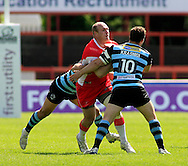 Michael Weyman (centre) of Hull Kingston Rovers is tackled by Scott Moore (left) and Olsi Krasniqi of London Broncos during the First Utility Super League match at the KC Lightstream Stadium, Kingston upon Hull<br /> Picture by Richard Gould/Focus Images Ltd +44 7855 403186<br /> 25/05/2014