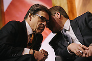 Texas Governor Rick Perry, left, speaks to Grover Norquist, president of Americans for Tax Reform, during day two of the Conservative Political Action Conference (CPAC) at the Gaylord National Resort & Convention Center in National Harbor, Md.