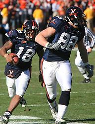 Virginia quarterback Marques Hagans (18) runs behind tight end Jonathan Stupar (88).  The Virginia Tech Hokies defeated The Virginia Cavaliers 52-14 on November 19, 2005 at Scott Stadium in Charlottesville, VA.