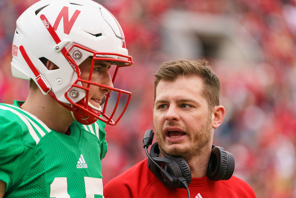 Noah Vedral #17 talks to an assitant coach during Nebraska's annual Spring Game at Memorial Stadium in Lincoln, Neb., on April 21, 2018. © Aaron Babcock