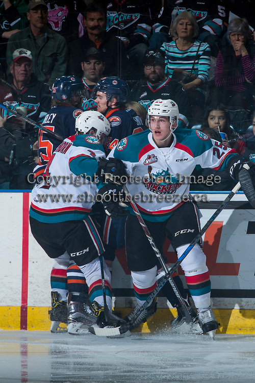 KELOWNA, CANADA - MARCH 31: Cal Foote #25 of the Kelowna Rockets skates out of a scrum against the boards against the Kamloops Blazers on March 31, 2017 at Prospera Place in Kelowna, British Columbia, Canada.  (Photo by Marissa Baecker/Shoot the Breeze)  *** Local Caption ***