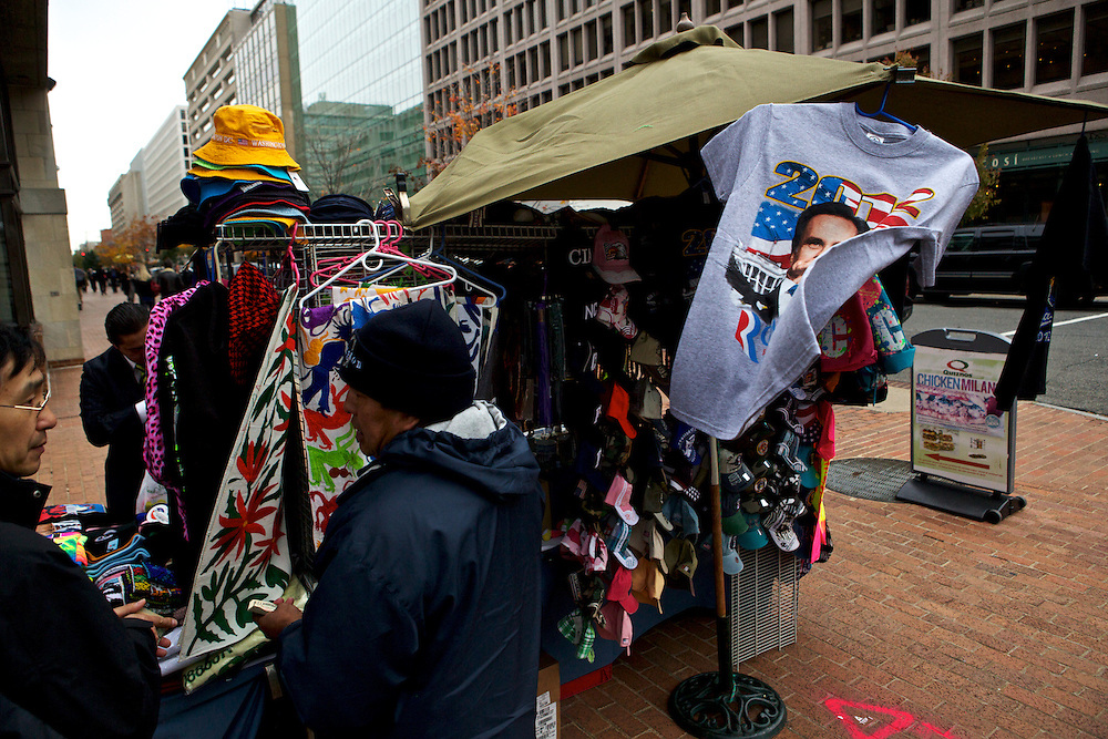 Leftover Mitt Romney memorabilia hangs from a vendor booth near White House on Nov. 7, 2012 in Washington, D.C. Marco Antonio Hernandez, second from left, a vendor who runs this vending table near Pennsylvania Ave., says business has been slow, but he hopes now that Obama has won the election he can move more merchandise.