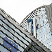 The tall arched building at the center of the European Parliament Building in Brussels, Belgium.