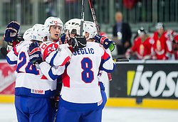 Players of Slovenia celebrate during ice-hockey match between Slovenia and Hungary at IIHF World Championship DIV. I Group A Slovenia 2012, on April 18, 2012 in Arena Stozice, Ljubljana, Slovenia.  (Photo by Vid Ponikvar / Sportida.com)