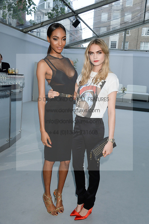 Left to right, JOURDAN DUNN and CARA DELEVINGNE at the Glamour Women of the Year Awards in association with Pandora held in Berkeley Square Gardens, London on 4th June 2013.
