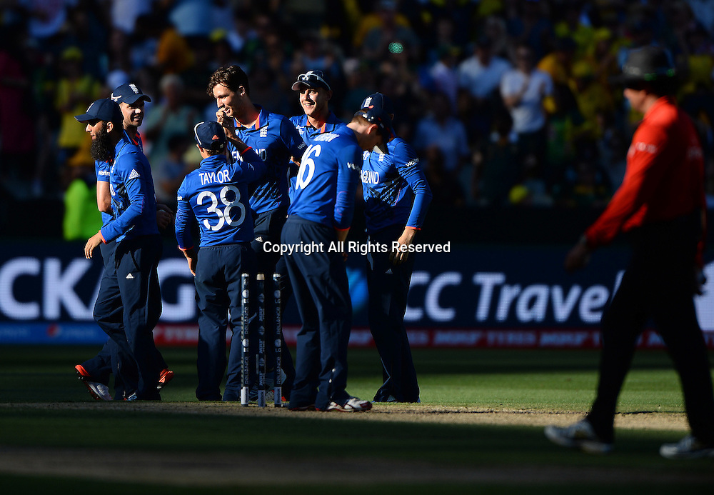 celebrating Steven Finn's hat trick<br /> Australia vs England / Match 2<br /> 2015 ICC Cricket World Cup / Pool A<br /> MCG / Melbourne Cricket Ground <br /> Melbourne Victoria Australia<br /> Saturday 14 February 2015<br /> &copy; Sport the library / Jeff Crow