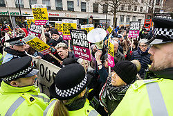 "© Licensed to London News Pictures . 09/02/2019. Manchester , UK . Police hold back anti-fascists protesting a "" Yellow Vest "" demonstration in Manchester City Centre . The yellow vest concept has been adopted from French demonstrators by some British groups in support of Brexit , Donald Trump and former EDL leader Stephen Yaxley-Lennon - aka Tommy Robinson . A similar demonstration in the city in January was ridiculed after protesters were kettled by police in front of a branch of Greggs the Baker . Photo credit : Joel Goodman/LNP"