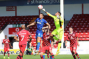 AFC Wimbledon defender Paul Robinson (6) and Walsall FC goalkeeper Neil Etheridge (1) jump during the EFL Sky Bet League 1 match between Walsall and AFC Wimbledon at the Banks's Stadium, Walsall, England on 6 August 2016. Photo by Stuart Butcher.