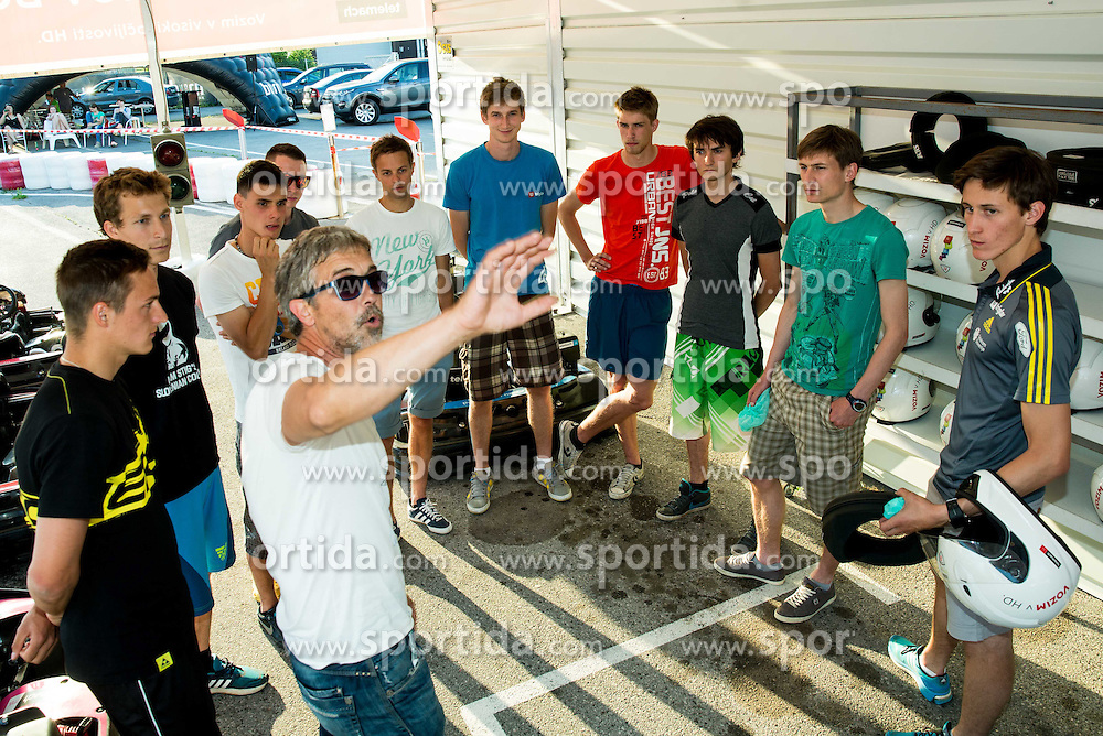 Vladimir Stankovic talks to Peter Prevc and others during Karting competition of Slovenian Ski jumping Men and Women Teams,  on June 5, 2015 in Pro Karting centre, Ljubljana, Slovenia. Photo by Vid Ponikvar / Sportida