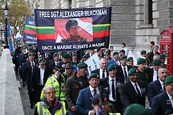 © Licensed to London News Pictures. 28/10/2015. London, UK. Royal Marines march to Downing Street during a rally calling for Sgt Alexander Blackman to be released.  Sgt Blackman was sentence for killing a Talliban insurgent in Afghanistan in 2011. He was convicted of murder at a court martial in 2013.   Photo credit: Peter Macdiarmid/LNP