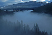 Fogbank over the Yaak River in fall. Yaak Valley, Montana