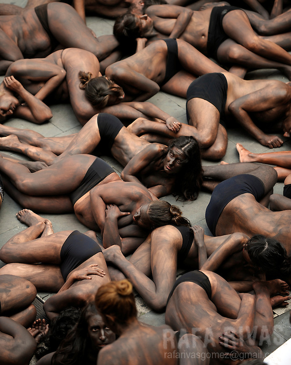 Members of PETA and Anima Naruralis pro animal groups lie on the ground in front of the Town Hall, to create a fighting bull shape, during a protest against bullfighting, in the Northern Spanish city of Pamplona, on July 4, 2010. PHOTO/Rafa Rivas