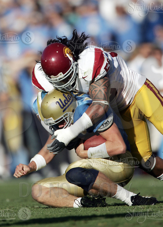 2 December 2006: Rey Maualuga tackles Patrick Cowan during Pac-10 college football upset UCLA beat the Trojans 13-9 during the final home game of the season for the UCLA Bruins vs the University of Southern California USC  Trojans at the Rose Bowl in Pasadena, CA.<br />