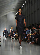 The DKNY collection is modeled during Fashion Week, Wednesday, Sept. 16, 2015, in New York.  The fashion show was on a 250-foot runway in the concourse to the PATH Transit Station under One World Center. (AP Photo/Diane Bondareff)