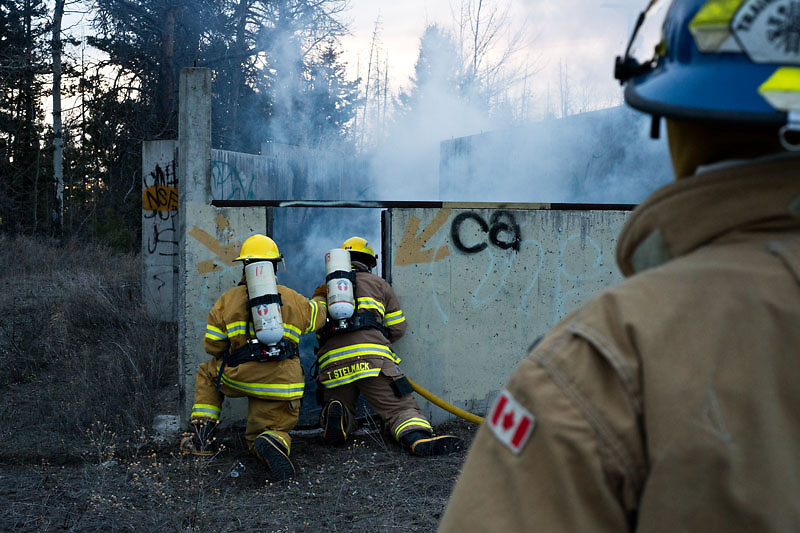 The Logan Lake Fire and Rescue crew training at an abandoned site in Logan Lake, BC.