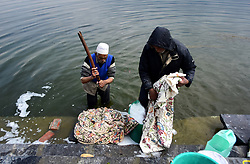 March 29, 2019 - Srinagar, India - Traditional Washer-man wash the kashmiri handicrafts  on the banks of Famous Dal lake in Srinagar, Jammu and Kashmir on 29 March 2019. (Credit Image: © Muzamil Mattoo/NurPhoto via ZUMA Press)