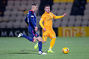 Nicky Cadden (#11) of Livingston FC closes down Aaron Hughes (#16) of Heart of Midlothian during the Ladbrokes Scottish Premiership match between Livingston FC and Heart of Midlothian FC at the Tony Macaroni Arena, Livingston, Scotland on 14 December 2018.