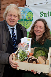"© Licensed to London News Pictures. 23/02/2012. Wallington, Surrey. Boris Johnon with Sutton Community Farm Manager Anna Francis. The Mayor of London, Boris Johnson and LOCOG Chairman Sebastian Coe today, 23 February 2012, showed off the benefits of urban food growing as they launched ""The Big Dig"" volunteer gardening weekend (16-17 March). This is all in support of Capital Growth, a scheme to create 2,012 community food growing spaces by the end of 2012.  Photo credit: Bettina Strenske/LNP"