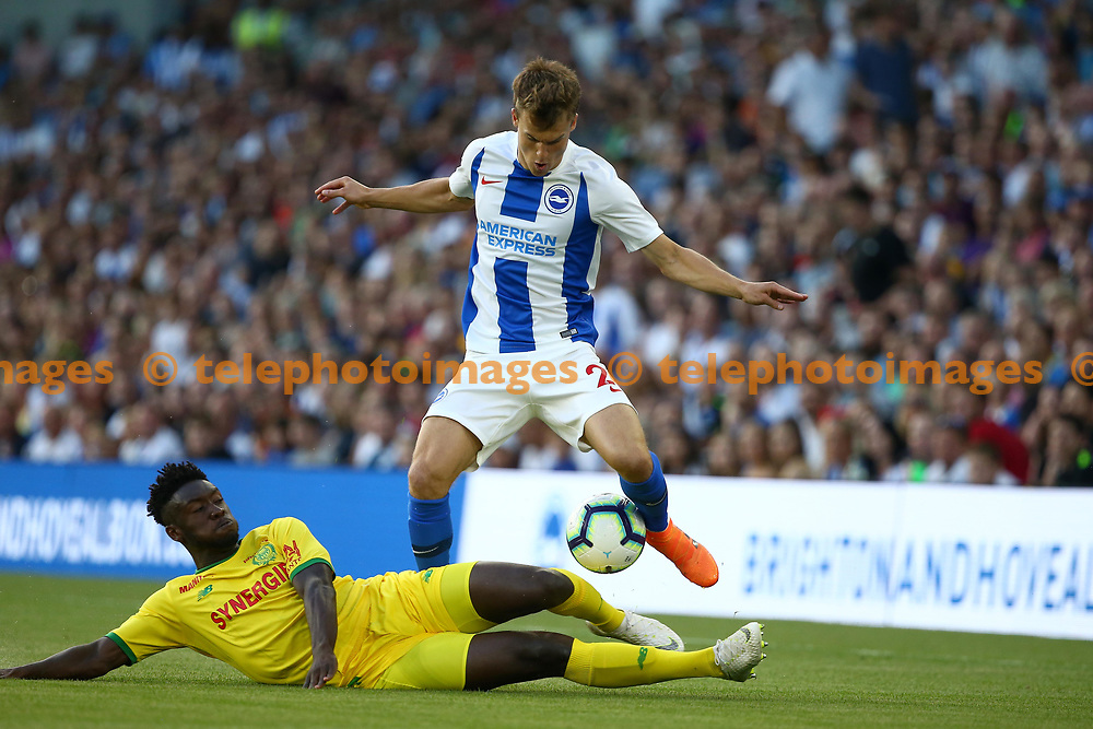 Enock Kwateng of FC Nantes tackles Solly March of Brighton during the pre season friendly between Brighton and Hove Albion and FC Nantes at the American Express Community Stadium in Brighton. 03 Aug 2018