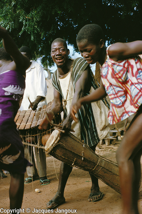 Village life in Africa: Girls of Bobo tribe dancing to the sound of drums and balafon xylophone in Koumbia, Burkina Faso, Africa.
