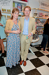 TOM NAYLOR-LEYLAND and his mother LADY ISABELLA NAYLOR-LEYLAND  at a party to launch Biscuiteers Fashion Biscuit Collection inspired by Alice Naylor-Leyland's wardrobe held at Biscuiteers, 194 Kensington Park Road, London W11 on 23rd June 2015.