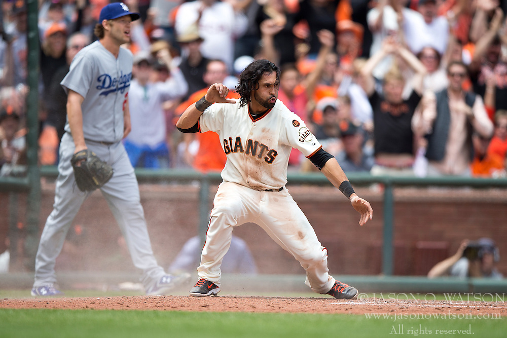 SAN FRANCISCO, CA - MAY 21: Angel Pagan #16 of the San Francisco Giants celebrates in front of Clayton Kershaw #22 of the Los Angeles Dodgers after scoring a run during the fourth inning at AT&T Park on May 21, 2015 in San Francisco, California. The San Francisco Giants defeated the Los Angeles Dodgers 4-0.  (Photo by Jason O. Watson/Getty Images) *** Local Caption *** Angel Pagan; Clayton Kershaw
