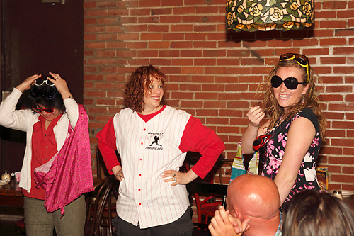 "Tamra Francis as Lee Pepper (center) with audience members during Mayhem & Mystery's production of ""Baseball Battle"" at the Spaghetti Warehouse in downtown Dayton, Monday, May 7, 2012."