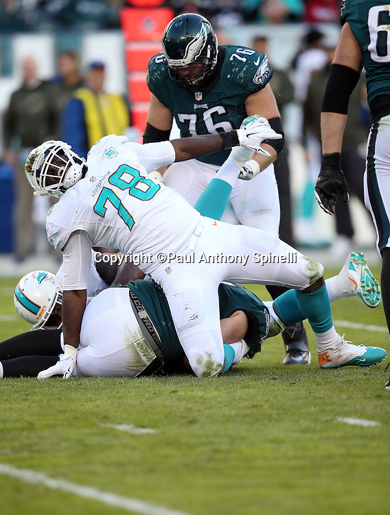 Miami Dolphins defensive end Terrence Fede (78) yells out in pain as he gets his leg caught under a pile of players during the 2015 week 10 regular season NFL football game against the Philadelphia Eagles on Sunday, Nov. 15, 2015 in Philadelphia. The Dolphins won the game 20-19. (©Paul Anthony Spinelli)