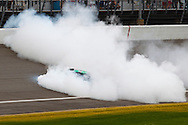 June 13, 2010: #11 Denny Hamlin in the FedEx Toyota does a burn out after winning the Heluva Good! Sour Cream Dips 400 NASCAR Sprint Cup Series at Michigan International Speedway in Brooklyn, Michigan.