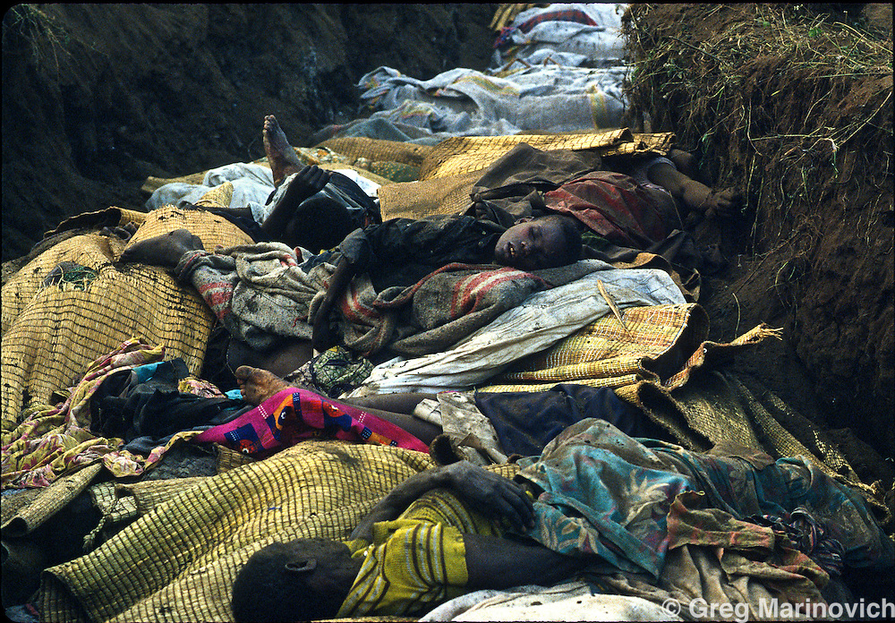Goma, Zaire, A dead child lies atop a pile of bodies from of a cholera epidemic in mass graves outside Goma, eastern Zaire. Millions of ethnic Hutus escaped the RPF takeover that followed and stopped the genocide of Rwandan Tutsis and Hutu moderates by extremist Hutus. 1994. Greg Marinovich