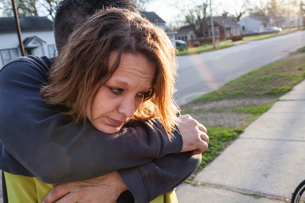Steve McFarland hugs his girlfriend Penny Johnson in front of their house on Friday, March 23, 2012 in Webster City, IA.