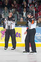KELOWNA, CANADA - NOVEMBER 21: Linesman Ron Dietterle stands on the ice wearing a CHL officials Movember fundraiser jersey at the Kelowna Rockets play the against the Portland Winterhawks on November 21, 2014 at Prospera Place in Kelowna, British Columbia, Canada.  (Photo by Marissa Baecker/Shoot the Breeze)  *** Local Caption *** Ron Dietterle; linesman, Movember;