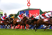 The horses pass the Winning Post on the first circuit of The Sky Bet Handicap Stakes over 2m (£70,000)  during the Ebor Festival at York Racecourse, York, United Kingdom on 21 August 2019.