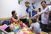 Plastic Surgeon Kenvin Caulder from Canada with a patients mother the follow morning after surgery.<br /> Isabel United Doctor Medical Centre. Operation Smile's 2015 mission to Cauayan city. Philippines. 14th -21st February 2015.<br /> <br /> (Operation Smile Photo - Zute Lightfoot)