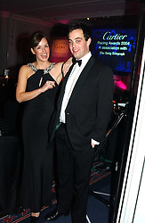 LORD BUCKHURST and LADY ROSE INNES-KER daughter of the 10th Duke of Roxburghe at the 2004 Cartier Racing Awards in association with the Daily Telegraph, held at the Four Seasons Hotel, London on 17th November 2004.<br />