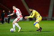 Alex Jakubiak of Bristol Rovers tracks down Tommy Rowe of Doncaster Rovers during the EFL Sky Bet League 1 match between Doncaster Rovers and Bristol Rovers at the Keepmoat Stadium, Doncaster, England on 26 March 2019.