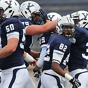 Candler Rich, Yale, (right), is congratulated by team mates  after scoring a touchdown during the Yale V Brown, Ivy League Football match at Yale Bowl. Yale won the match 24-17. New Haven, Connecticut, USA. 9th November 2013. Photo Tim Clayton