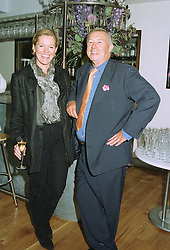 MISS VICTORIA DAVIS and SIR TERENCE CONRAN at a party in London on 27th August 1997.MAU 3