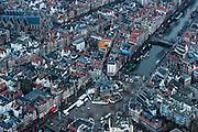 Nederland, Noord-Holland, Amsterdam, 16-01-2014;<br /> Historische centrum van Amsterdam rond de Nieuwmarkt (m) met de Waag, de Oude kerk (l) hoger in beeld, met daartussen de rosse buurt (Wallen). De Geldersekade (na de Nieuwmarkt rechts). <br /> storic center of Amsterdam around the Nieuwmarkt (m) with the Waag (Weigh house), the Old Church (l,t), between them the red light district.<br /> luchtfoto (toeslag op standard tarieven);<br /> aerial photo (additional fee required);<br /> copyright foto/photo Siebe Swart