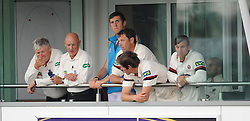 The Somerset team talk to umpire's Martin Bodenham and Jeff Evans whilst the rain falls. - Mandatory byline: Alex Davidson/JMP - 07966386802 - 22/08/2015 - Cricket - County Ground -Taunton,England - Somerset CCC v Worcestershire CCC - LV= County Championship Division One - Day 3