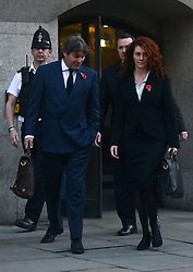 © Licensed to London News Pictures.28/10/2013. London, UK. Rebekah Brooks, the former head of News International and her husband Charlie Brooks leave Old Bailey court on October 28, 2013 in London where she faces charges relating to phone hacking scandal. Photo credit : Peter Kollanyi/LNP